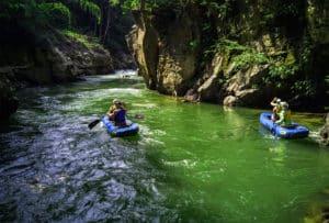Boat paddling on green river